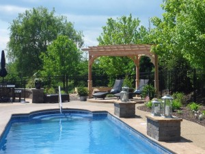 pergola and outdoor furniture by a pool