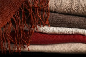 pile-woolen-sweaters-scarf-several-stacked-top-each-other-top-them-45099335