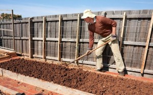 how-to-prepare-a-garden-bed-for-planting-preparation-of-soil-for-planting-man-soil-in-raised-garden-bed-preparing-garden-bed-for-spring-planting